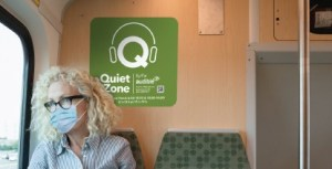 Image is of a rider with a Quiet Zone image behind her.