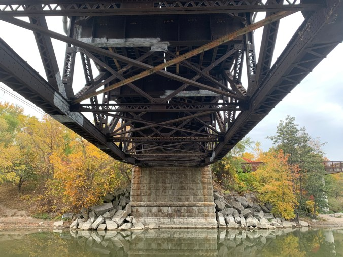 Image shows the under side of a rail bridge.