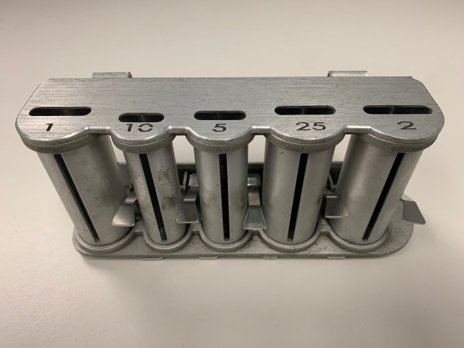 Photo of a new model coin dispenser with slots for all of the Canadian currency