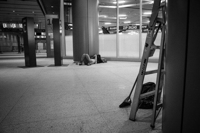 A worker relaxes on the floor.