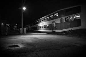 Image is of a train at night.