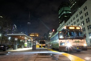 Images of buses at a station.