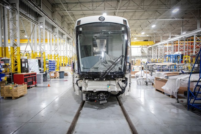 A LRV is shown inside the assembly plant.