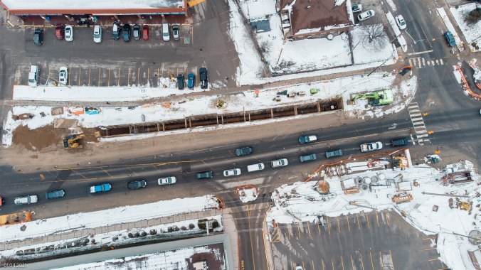 Image looks down on traffic from above, as work takes place nearby.