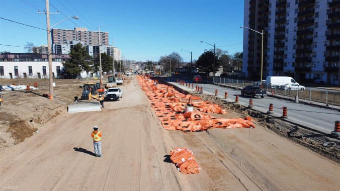 Image shows crews widening the road.