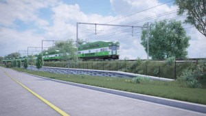 Image shows a GO train powered by overhead wires.