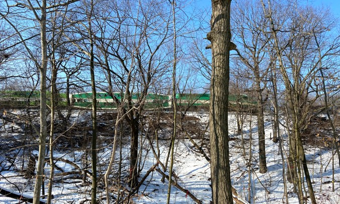 A GO Train travels along the Lakeshore East corridor just beyond the ravine. (Metrolinx photo)