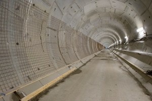 Image shows a long and well lit tunnel.