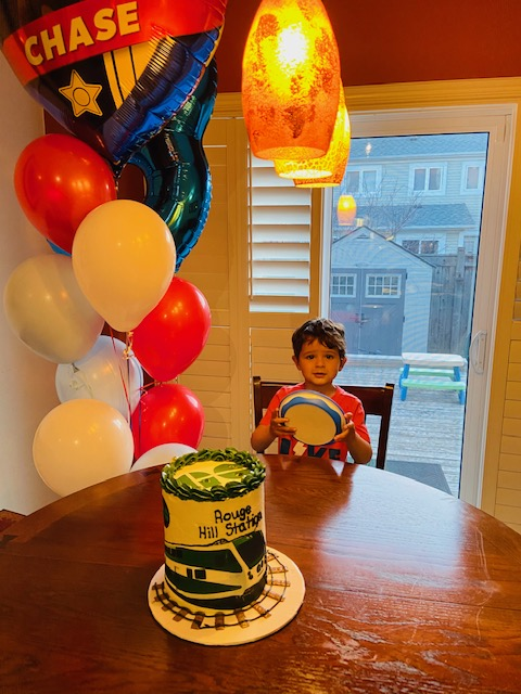 Little boy (Bodhi) with his cake and balloons