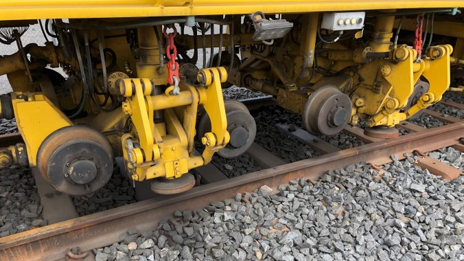 Close up shot of the stabilizer wheels that simulate the locomotive's weight