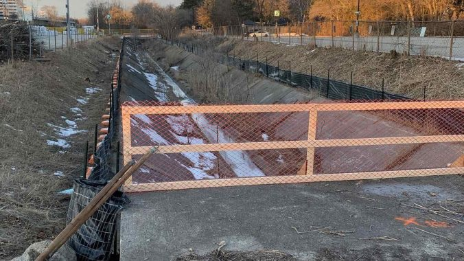 Construction fencing around a small creek