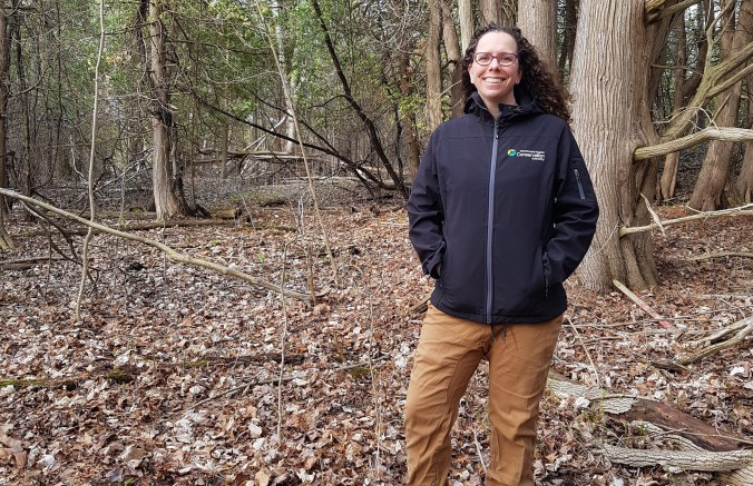 photo of TRCA employee Kelly Jamieson in a forest