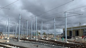 Image shows the power lines and poles next to the tracks.