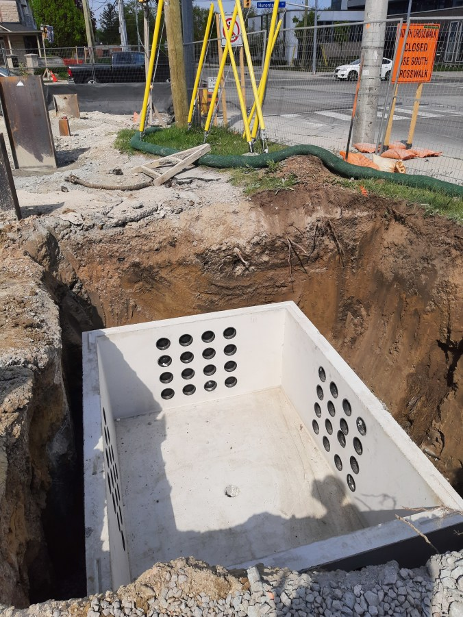 Image shows a concrete box in the ground.