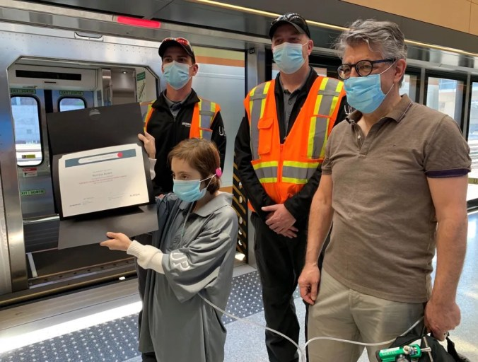 Romina and her father stand next to Alstom engineer Tony Borek and Alstom conductor Aaron Trude