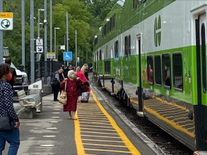 Riders step aboard a Niagara GO train on the first weekend.