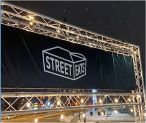 Image shows the Street Eats sign in lights.