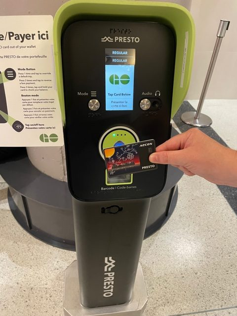 Image of a PRESTO card being used ot a machine.