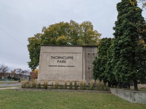 Image shows a large stone Thorncliffe Park sign
