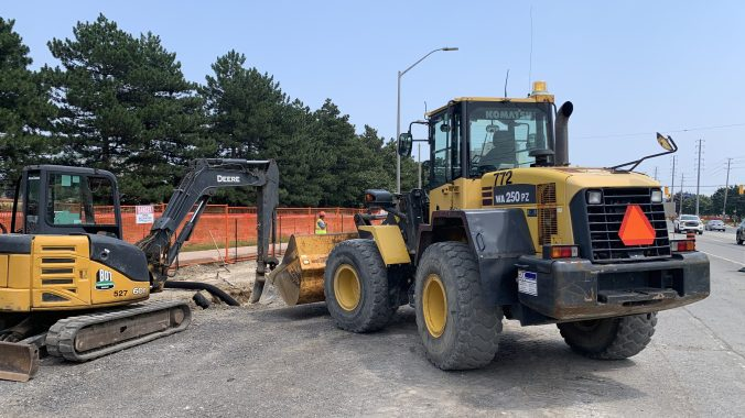 An excavator and a loader work on widening Hurontario Street between Matheson Boulevard and Traders Boulevard.