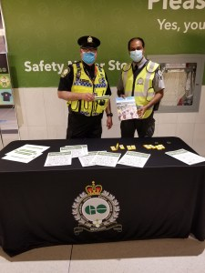 Image shows officers standing next to a table.