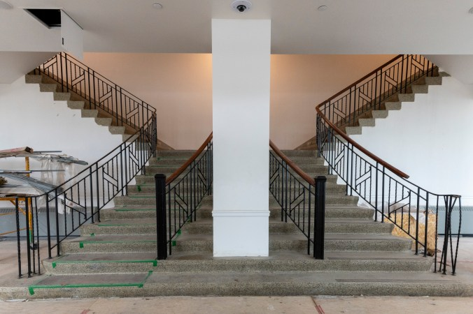 Image shows stairs split and going up.