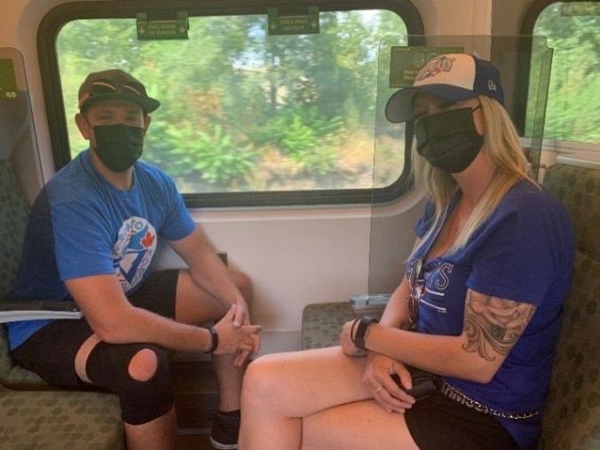 Image shows the couple on the train.