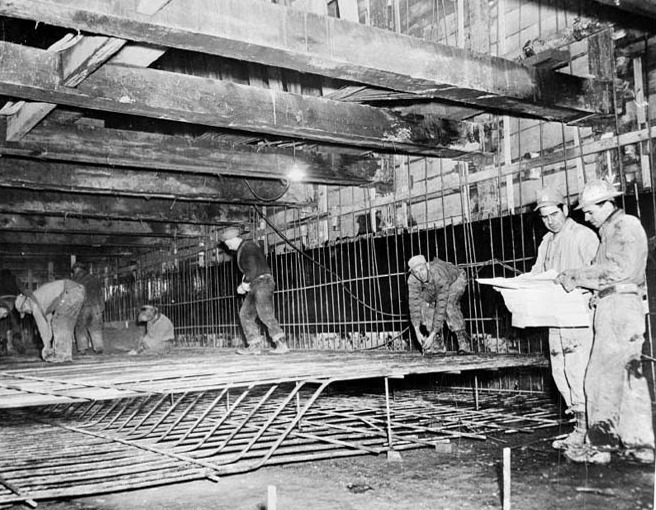 Image shows workers toiling on the subway.