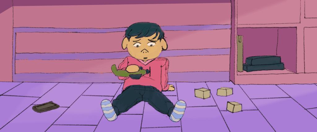 criança triste sentada no chão brincando sozinha