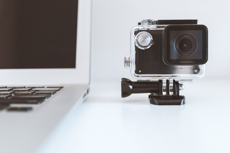 camera next to a laptop to create a fundraising video