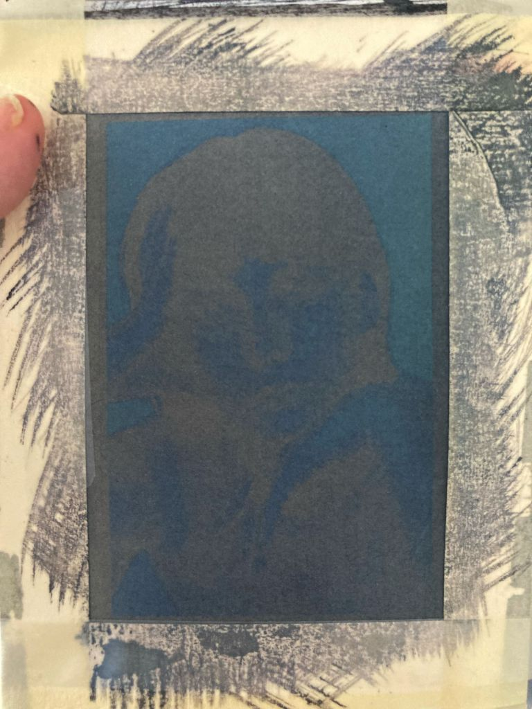 An exposed cyanotype portrait, inverted and blue and brown