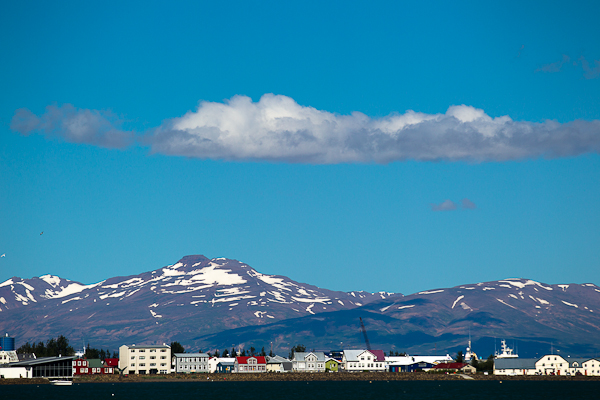 Akureyri is surrounded by snow-capped mountains.