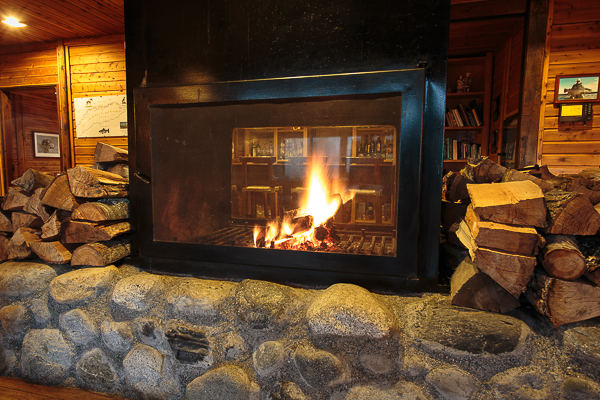 The fireplace is the central focus of the lodge.