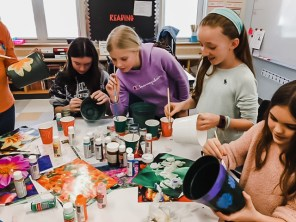 Students on the Pierce Green Team, along with advisor Oliva Hupp and volunteer Beth Neville, are cloning Swedish Ivy from a mantle that grows in the White House.