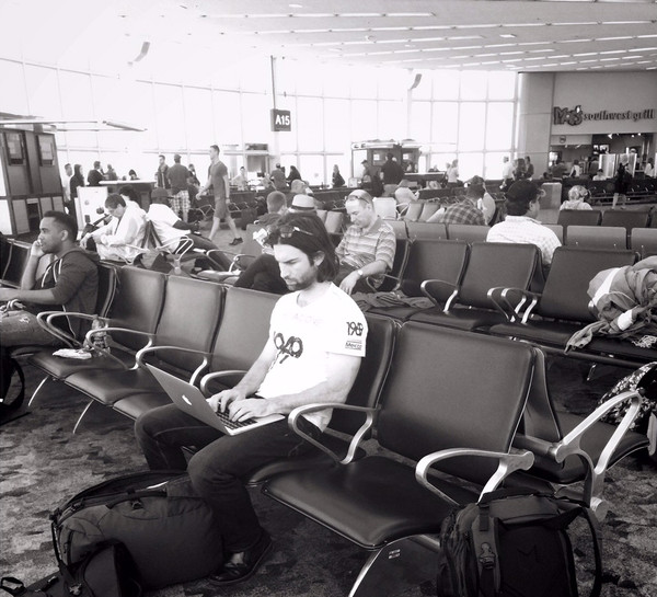 Doug Working from the Departures Lounge with his Minaal Carry-on Backpack