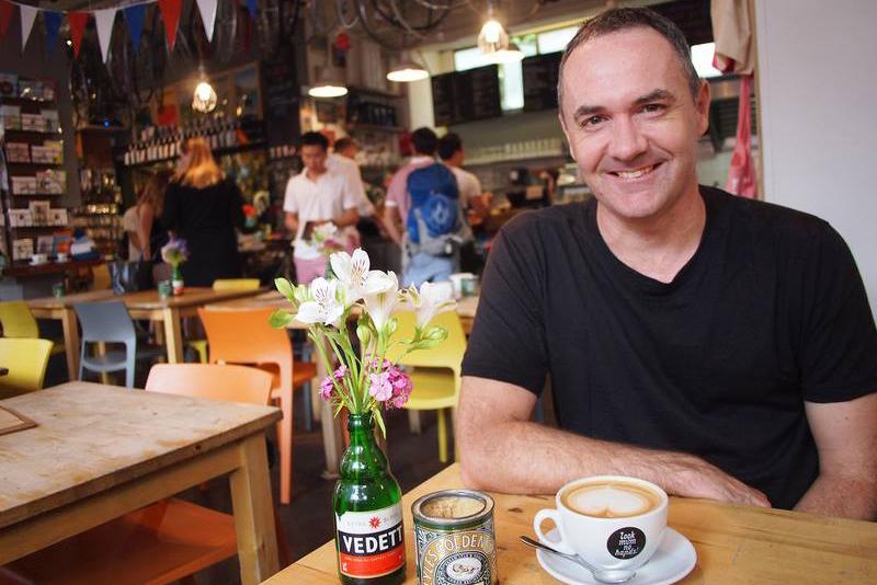 Digital Nomad James Clark At a Cafe in London