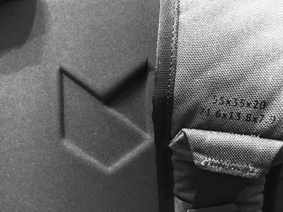Minaal Carry-on 2.0 travel backpack carry-on bag size dimensions on left shoulder