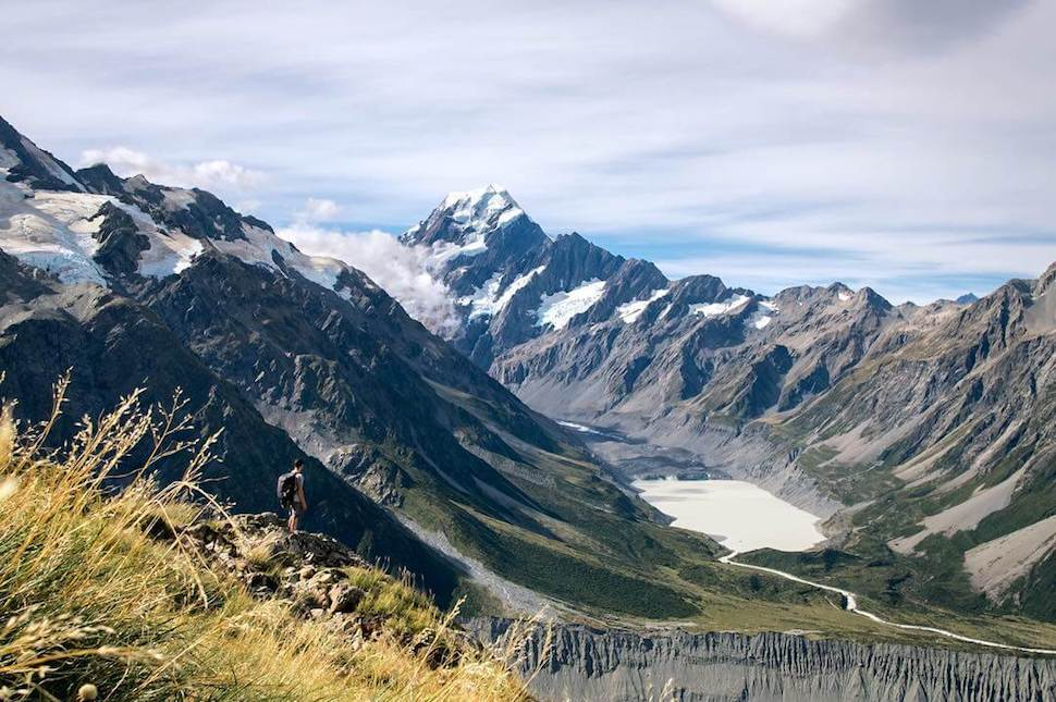 Joshua lost in the landscape of Milford Sound, New Zealand with his Minaal Carry-on 1.0 hiking backpack.