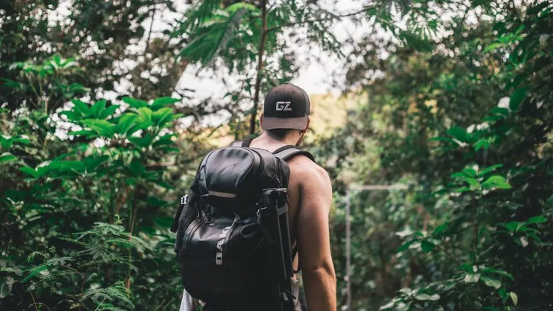 Man hiking in the forest as an extraordinary human being