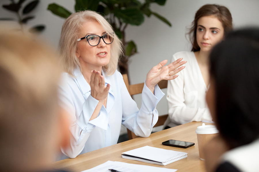 woman in white shirt conducting an effective meeting