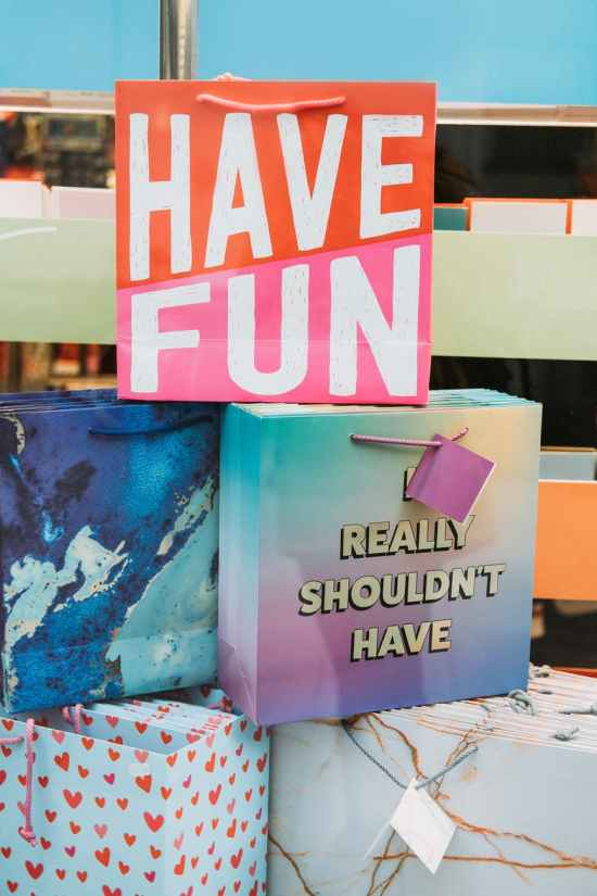 have fun inscription on gift bag in shop