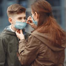 mother help kids wearing mask
