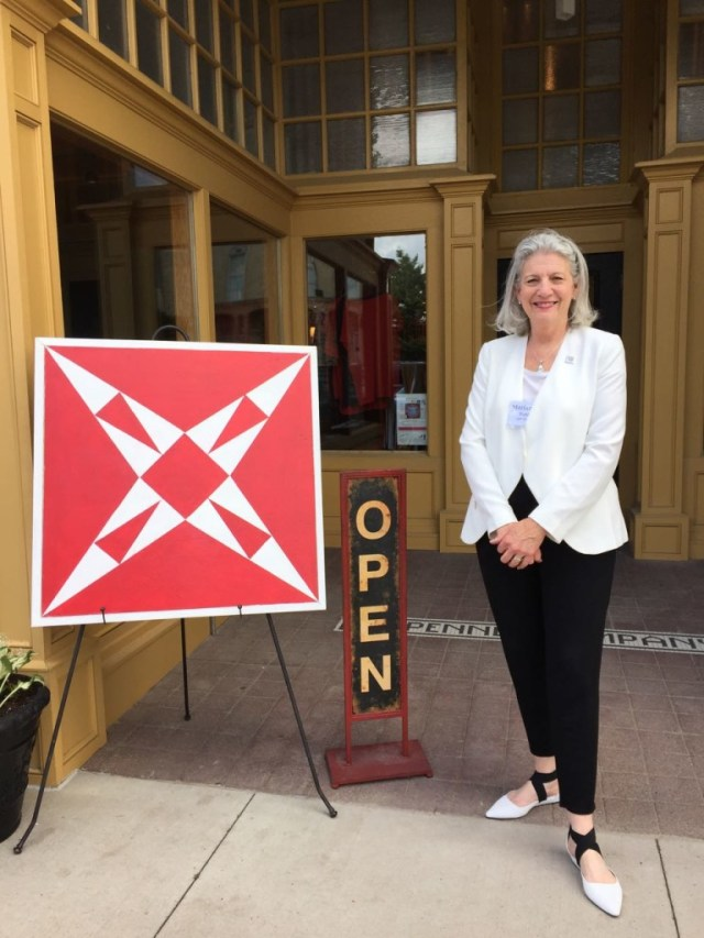 Marianne Fons welcomes visitors to the Grand Opening of the Iowa Quilt Museum.