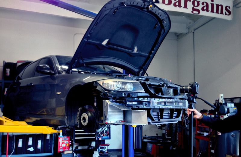 A BMW E9X 335 at ModBargains being fitted with an Evolution Racewerks Oil Cooler