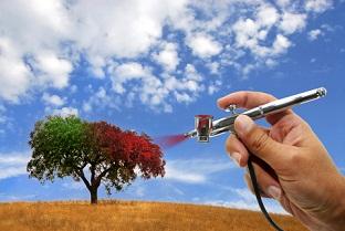 Airbrushing a tree.