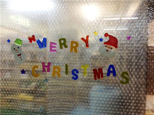 Our entrance doors are decorated with kawaii Christmas stickers