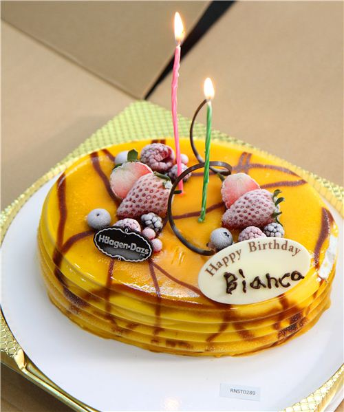 The mango ice cream cake tasted divine but was hard as stone