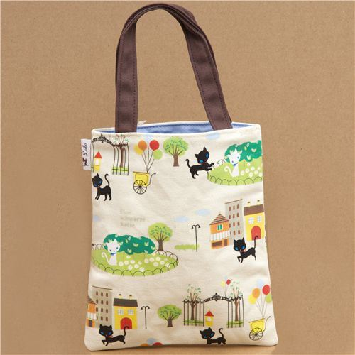 cute beige kitty handbag in the city park from Japan