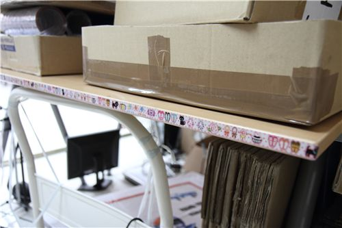 cute pink deco tape along the side of our packing table