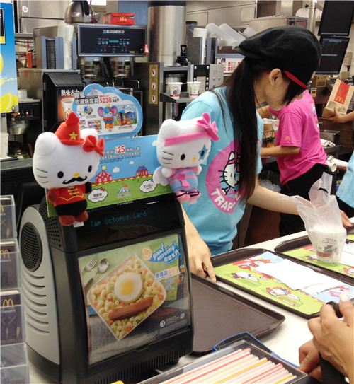The Hello Kitty plushies are displayed on the cashiers in every McDonalds in Hong Kong